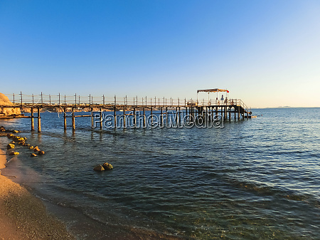 red sea beach with parasols at