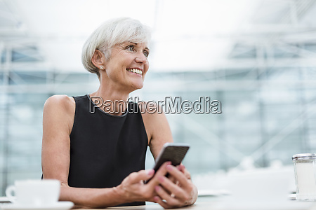 smiling senior woman with cell phone