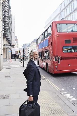 uk london senior businessman with luggage