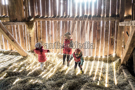 three little girls playing together in