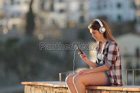 relaxed girl listening to music with