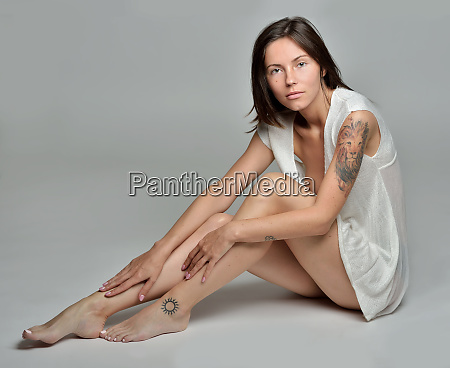 barefoot woman only in panties sitting