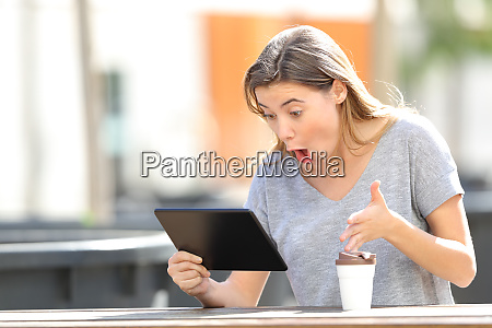 amazed teenage girl using a tablet