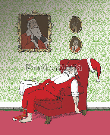 exhausted father christmas asleep in armchair