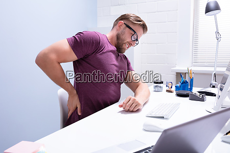 young businessman having back pain
