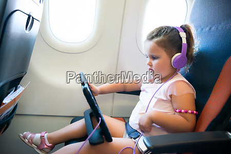 little girl using digital tablet in