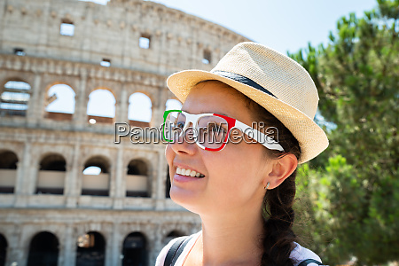 female tourist in front of colosseum