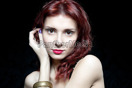 head of beautiful woman with red