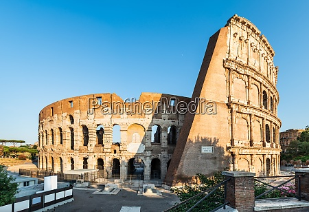 panorama of colosseum at sunrise in