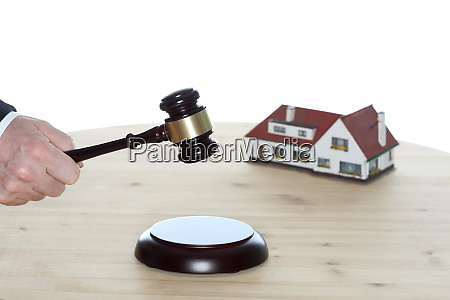auctioneer with gavel in hand is