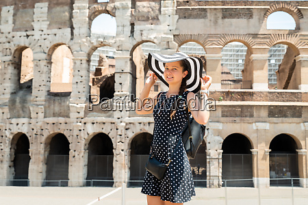 woman standing in front of colosseum