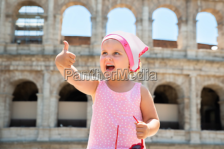 girl tourist in front of colosseum