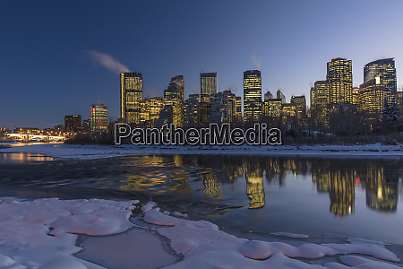 winter city skyline reflects in the