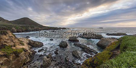 cove of rocks and waves along