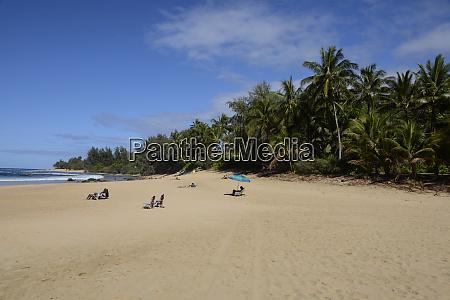 sunbathers w haena state park kee