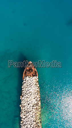 aerial view of artificial pier with