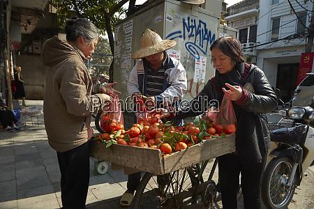 street vendor old quarter hanoi vietnam