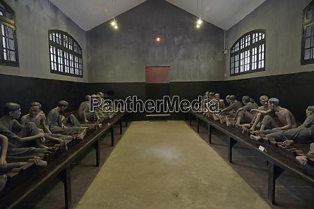 life sized model of shackled prisoners