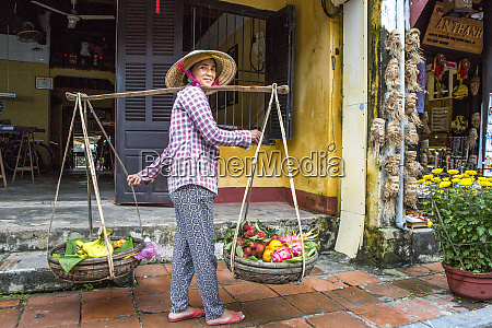 street vendor carrying her fruit and