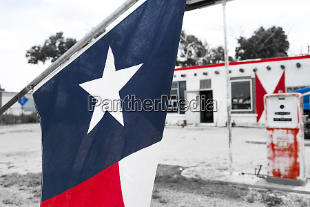 flag at an antique gas station