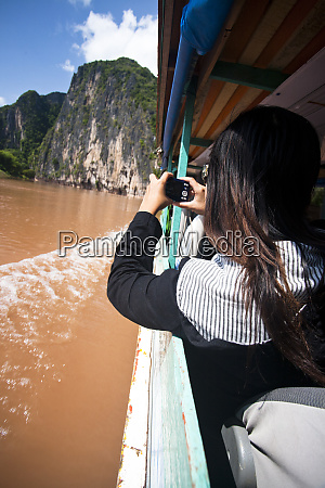 people take a long boat taxi