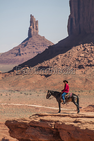 navajo man on horseback monument valley
