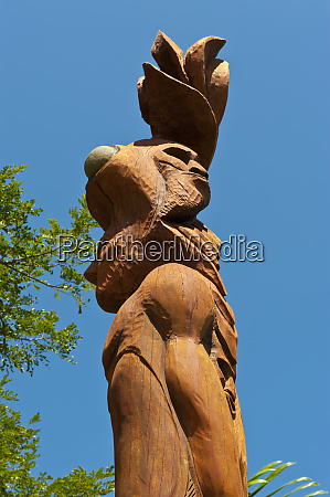 wooden statues in the sculptures garden