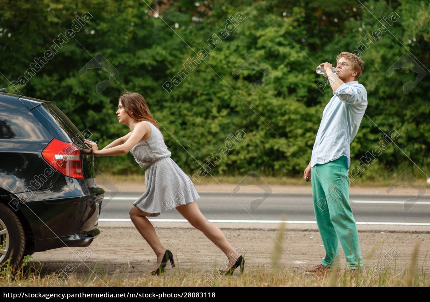man, and, woman, pushing, broken, car - 28083118