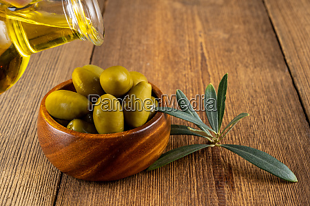 olive oil is poured from a