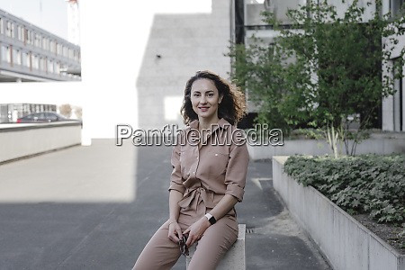confident, businesswoman, sitting, outside, office, building - 28753853