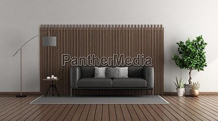 nowoczesny salon z czarna skorzana sofa