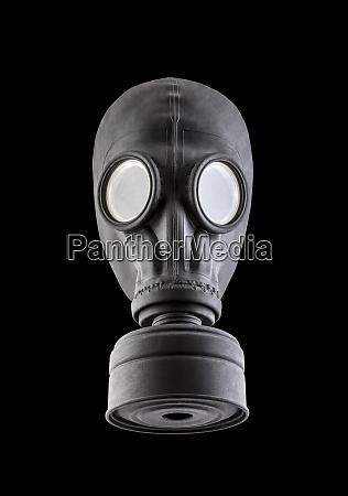 czarna maska gazowa wyizolowana na czarnym